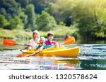 child with paddle on kayak.... | Shutterstock . vector #1320578624