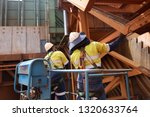 workers inspector on elevating... | Shutterstock . vector #1320633764