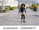 young fit black woman on roller ... | Shutterstock . vector #1320660677