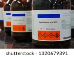 Small photo of Bottle of Hydrochloric Acid, HCL with Properties information and its chemical hazard warning symbols. Corrosive, Inhalation,Toxic warning, Hazardous to the Environment.