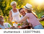 family having a lunch in their... | Shutterstock . vector #1320779681