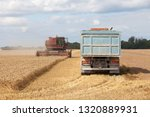 Vintage Red Combine Working On...