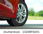 tire and alloy wheel on this... | Shutterstock . vector #1320893651
