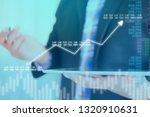 businessman on digital stock... | Shutterstock . vector #1320910631