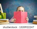 little primary schoolgirl read... | Shutterstock . vector #1320922247