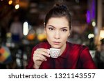 beautiful young brunette... | Shutterstock . vector #1321143557