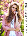 Small photo of Spring fashion portrait of stylish elegant glamour model with curly long flunky natural hairs and trendy make up and jewelry