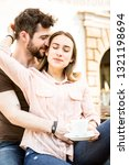 young couple in love enjoying a ... | Shutterstock . vector #1321198694