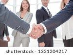 close up.handshake business... | Shutterstock . vector #1321204217