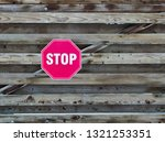 close up of stop  road sign on... | Shutterstock . vector #1321253351