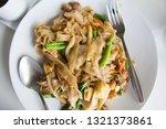 stir fry noodles  in white bowl.   Shutterstock . vector #1321373861