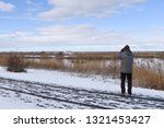 birdwatcher watching in a... | Shutterstock . vector #1321453427