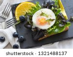 fried egg with bread toast on...   Shutterstock . vector #1321488137