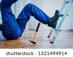 construction worker falling... | Shutterstock . vector #1321494914