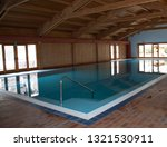 swimming pool with wooden roof | Shutterstock . vector #1321530911