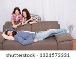 family prank. little girl with... | Shutterstock . vector #1321573331