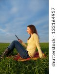 teen girl reading electronic... | Shutterstock . vector #132164957