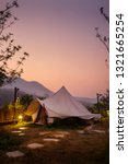 Stock photo view of the canvas tent to camp when vacation and relax time on mountain at early golden hour 1321665254