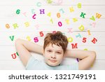 little boy with rainbow... | Shutterstock . vector #1321749191