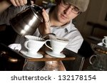 barista brews a single cup a... | Shutterstock . vector #132178154