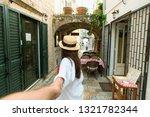 follow me concept. woman...   Shutterstock . vector #1321782344