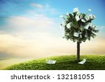 photo of tree made of dollars | Shutterstock . vector #132181055
