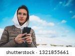 girl hold in hands mobile phone ... | Shutterstock . vector #1321855661