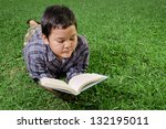 young asian boy reading a book... | Shutterstock . vector #132195011