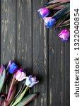 tulip flower on black wooden... | Shutterstock . vector #1322040854