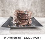 Small photo of Nasty looking chocolate cake with sprinkles.