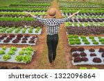 farmers smiling and standing in ... | Shutterstock . vector #1322096864