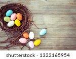 colorful easter eggs in nest on ... | Shutterstock . vector #1322165954