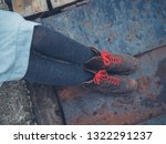 the feet and legs of a young... | Shutterstock . vector #1322291237