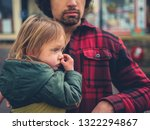 a little toddler is being... | Shutterstock . vector #1322294867