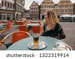 young blond woman sitting in... | Shutterstock . vector #1322319914