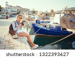 photography and travel. young... | Shutterstock . vector #1322393627