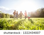 group of kids playing outdoors... | Shutterstock . vector #1322434007