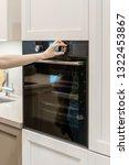 vertical photo of woman hand... | Shutterstock . vector #1322453867