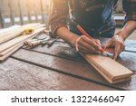 carpenter working with... | Shutterstock . vector #1322466047