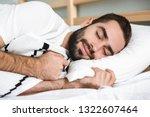 handsonme smiling man sleeping...   Shutterstock . vector #1322607464