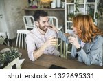 urban young couple drinking... | Shutterstock . vector #1322695331