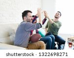 male fans celebrating score and ... | Shutterstock . vector #1322698271