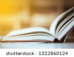 stack of books in the library... | Shutterstock . vector #1322860124