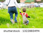 lovely mother and boy walking... | Shutterstock . vector #1322883494
