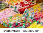 assorted sweets and candies in... | Shutterstock . vector #1323009404