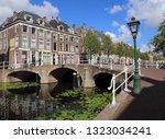 historical bridge across a... | Shutterstock . vector #1323034241