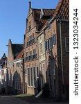 gables of historical houses in... | Shutterstock . vector #1323034244