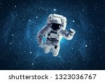 astronaut in outer space.... | Shutterstock . vector #1323036767