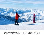 family of skiers at hintertux... | Shutterstock . vector #1323037121