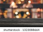 selective empty wooden table in ... | Shutterstock . vector #1323088664